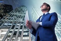 The businessman against buildings in business concept Royalty Free Stock Photography