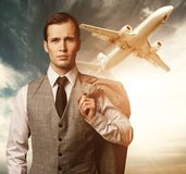 Businessman against flying plane Stock Images