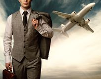 Businessman against flying plane Stock Image