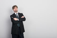 Businessman against a gray wall Royalty Free Stock Photo