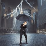 Businessman against lightning. Businessman is repaired by thunder and lightning Royalty Free Stock Photography