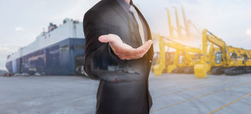 Free Businessman Against Logistics Import Export Tracts Vehicle Royalty Free Stock Photo - 82566495