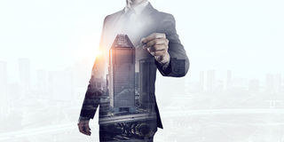 Businessman against modern city background Royalty Free Stock Images