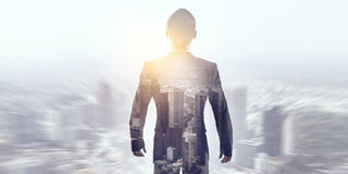 Businessman against modern city background . Mixed media Royalty Free Stock Image