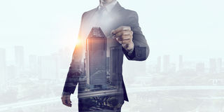 Businessman against modern city background . Mixed media Royalty Free Stock Photography