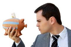 Businessman against the money pig Stock Image
