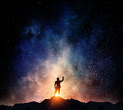 Businessman against starry sky . Mixed media Royalty Free Stock Images