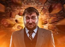 Businessman agaist brick wall Stock Photos