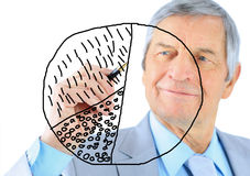 Businessman in age, draws a graph. Stock Photography