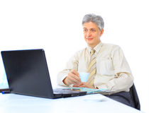 The businessman at the age of works Royalty Free Stock Image