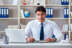 The businessman agent working in the office Royalty Free Stock Photo