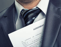 Businessman with agreement Stock Photos