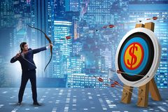 The businessman aiming arrow with bow. Businessman aiming arrow with bow royalty free stock image