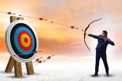 The businessman aiming arrow with bow. Businessman aiming arrow with bow stock photography