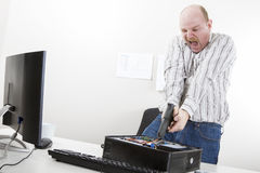 Businessman Aiming Gun On CPU At Desk Stock Photography