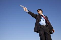 Businessman aiming a handgun Stock Images
