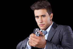 Businessman aiming a handgun Stock Images