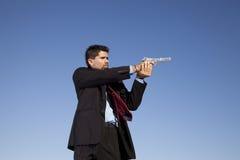 Businessman aiming a handgun Royalty Free Stock Photo