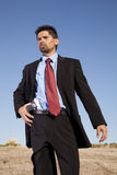 Businessman aiming a handgun Royalty Free Stock Photography