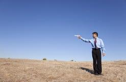 Businessman aiming a handgun Stock Photo