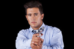 Businessman aiming a handgun Royalty Free Stock Photos