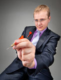 Businessman aiming by red dart Royalty Free Stock Image