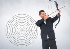 Businessman aiming at the target board against grey background Stock Photos