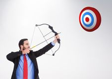 Businessman aiming at the target board against white background Royalty Free Stock Photography