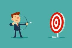 Businessman aiming target with bow and arrow Royalty Free Stock Photos
