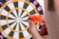 Businessman aiming to target. By red dart Royalty Free Stock Photos