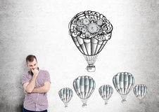 Businessman airballoons gears Royalty Free Stock Photos