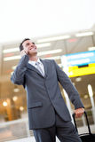 Businessman at airport Stock Image