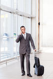 Businessman at airport Royalty Free Stock Photography