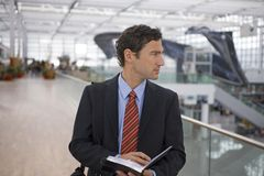 A businessman at an airport. stock images