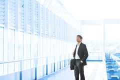 Businessman at airport Stock Photography