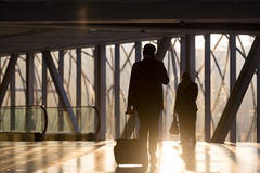 Businessman at airport corridor walking to departure gates. Stock Image