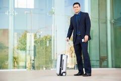 Businessman at an airport Stock Photo