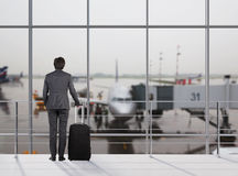 Businessman in airport Royalty Free Stock Photo