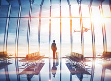 Businessman at airport with suitcase Royalty Free Stock Photos