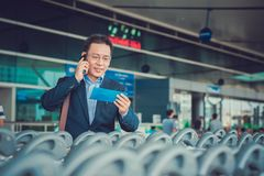 Businessman in airport Royalty Free Stock Image