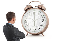 Businessman and alarm clock Royalty Free Stock Image