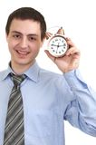 Businessman with an alarm clock in a hand. stock photo