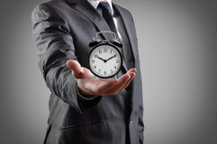 Alarm clock in a hand. Royalty Free Stock Photo