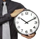 Businessman with alarm clock Stock Photos