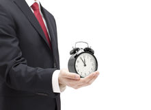 Businessman with an alarm clock in a hand Royalty Free Stock Photo