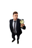 Businessman with alarm clock. Stock Photos