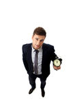 Businessman with alarm clock. Royalty Free Stock Image