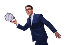 The businessman with alarm clock isolated on white Royalty Free Stock Photos