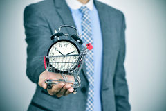 Businessman with an alarm clock in a shopping cart Stock Image