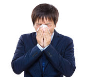 Businessman with allergy sneezing Stock Photography